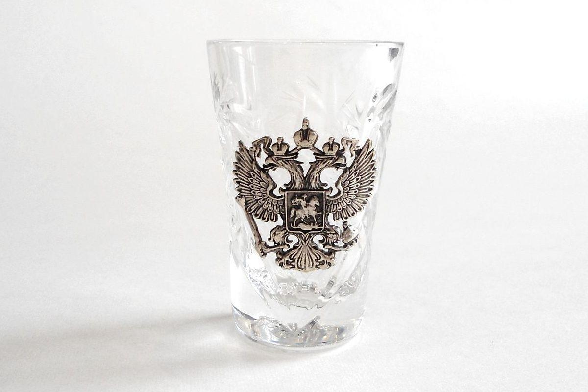 Герб России из серебра на стопке